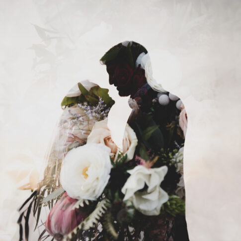 A double exposure of the bridal bouquet overlaid on a silhouette of a wedding couple.