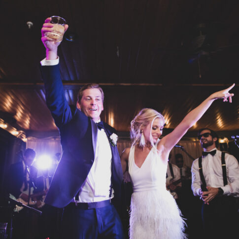Man and wife celebrate with a dance at their wedding reception.