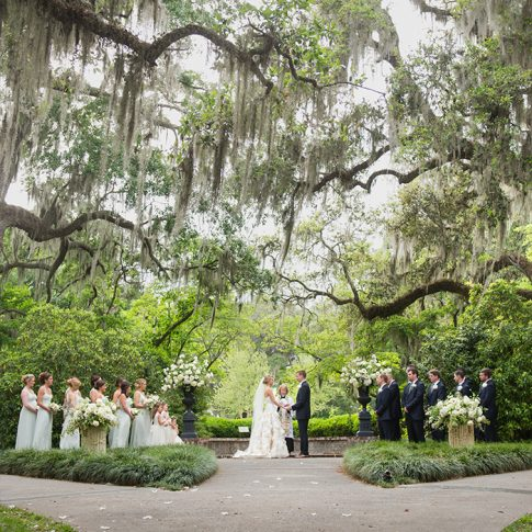 A bride and groom say their vows under three hundred year old oak trees in Murrells Inlet, SC.