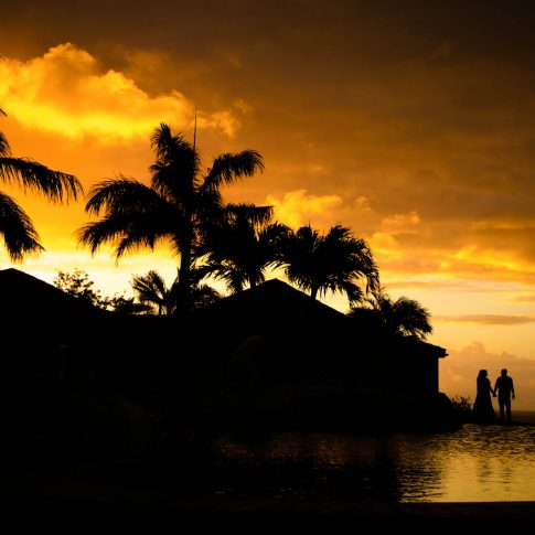 A couple holds hands and overlooks the breathtaking scenery of Saint Martin, an island in the northern Caribbean.