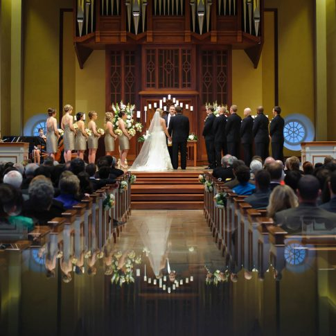 A serene moment at the altar where the bride and groom pay close attention to the words of the officiator.
