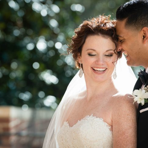Shot in Daniel Chapel at Furman University in Greenville, SC, the joyous newlyweds share an intimate moment of laughter.
