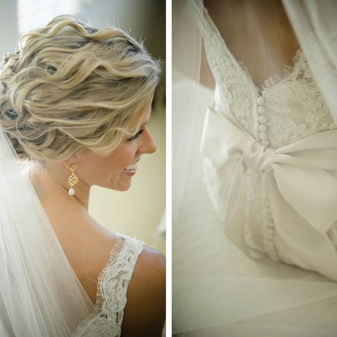 Gorgeous details are captured of the brides gold and pearl teardrop earrings which beautifully compliment her curled undo and tulle veil as well as the pristine satin bow that helps to secure the back of her white lace gown.