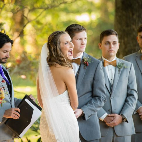 A bride has a moment of laughter during her vows.