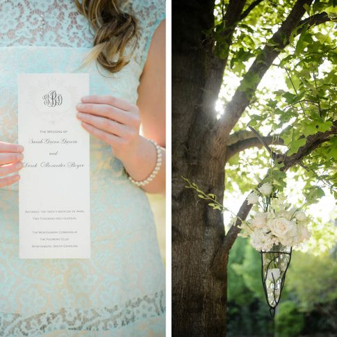 A detail shot of the delicate script of a wedding invitation paired with a white floral arrangement hanging from a tree.