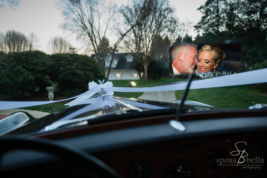 The newlyweds snuggling in the back seat of the Rolls, while I photographed them in the rearview mirror.
