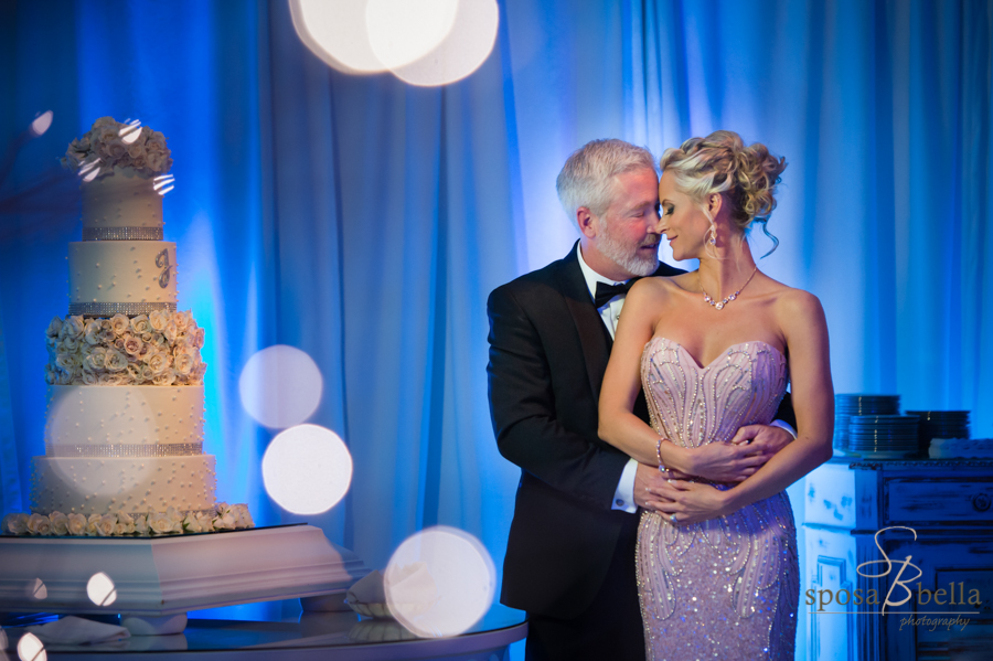 Dramatic uplighting (here seen in blue) add so much to the background of photos, and look at that incredible cake!