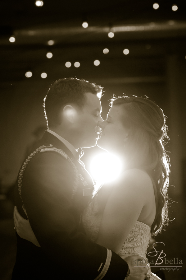 The moment before a kiss with the glow of the twinkle lights and our flash positioned behind the newlyweds.