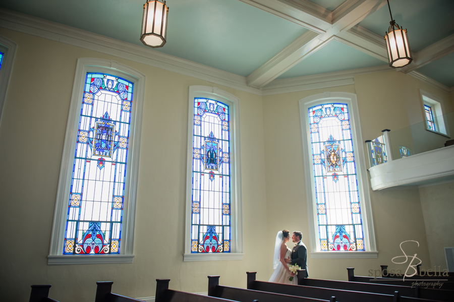 Beautiful stained glass from the Trinity Church of Greenville, and the newlyweds bathed in sunlight!