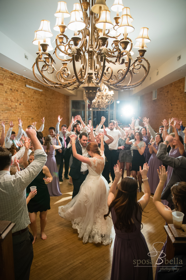At the end of the reception, Blake from Jumping Jukebox had the guests circle around the bride and groom for one last dance. I just love this moment with everyone's hands in the air in celebration.