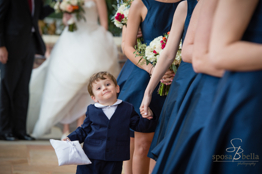 Adorable ring bearer lines up to enter the wedding ceremony at the Daniel Chapel at Furman University.