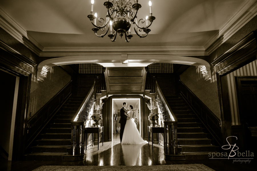 A bride and groom in the Poinsett Club staircase. Greenville, SC 2017