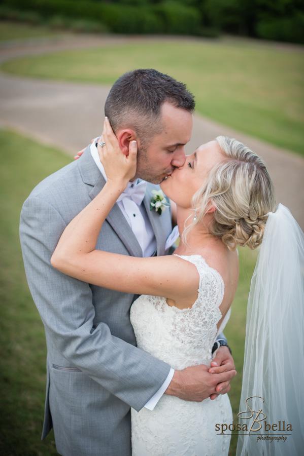 Bride and Groom kiss at their Reserve at Lake Keowee wedding.