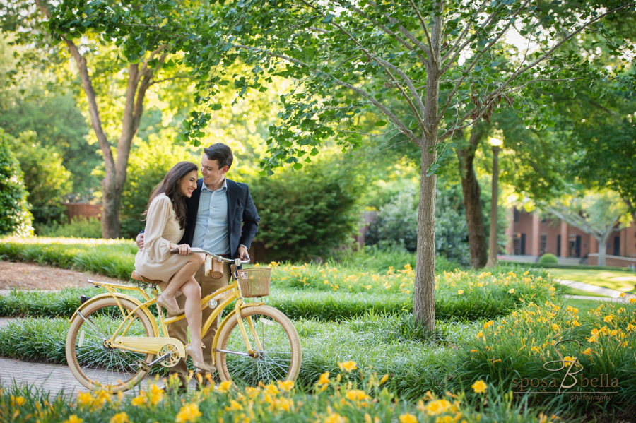 Soon-to-be husband guides his fiance on a bike ride through Furman University.