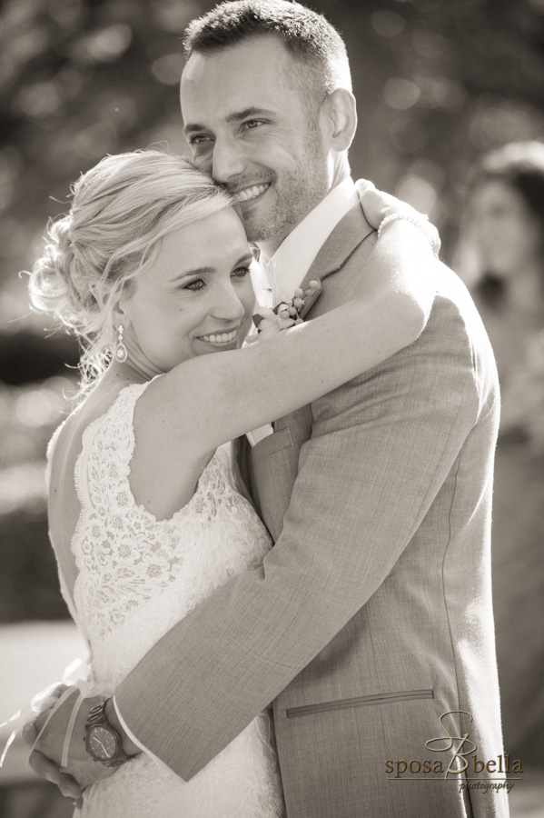 Newlyweds hug and smile after their wedding.