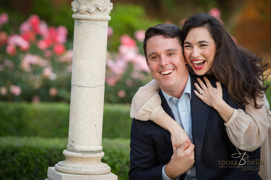 Couple laughs and embraces at the Furman Rose Garden.
