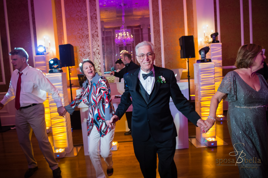 Father of the groom dancing at the reception.