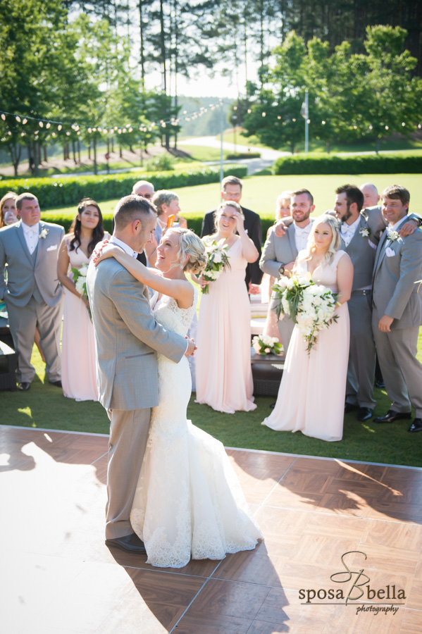 Happy newlyweds dancing at their Reserve at Lake Keowee reception.