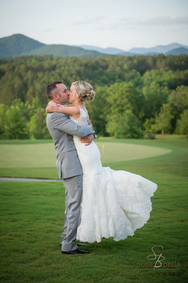 Bride and groom kiss with a views on the Blue Ridge mountains in the background.