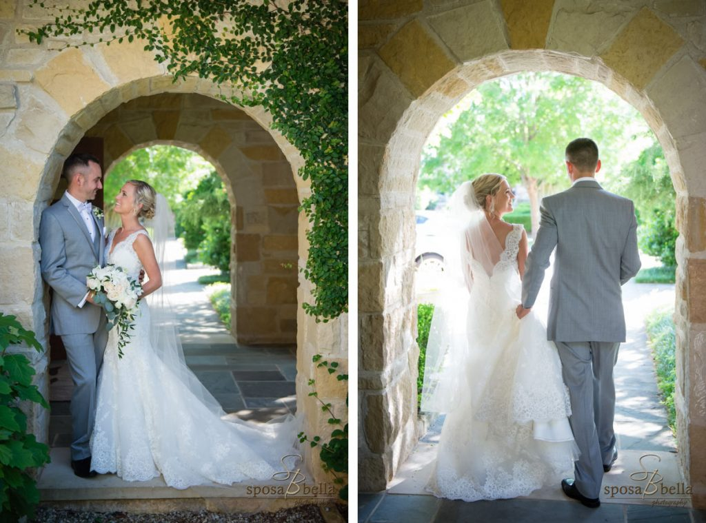 Newlyweds posed under a stone arch at a wedding chapel.