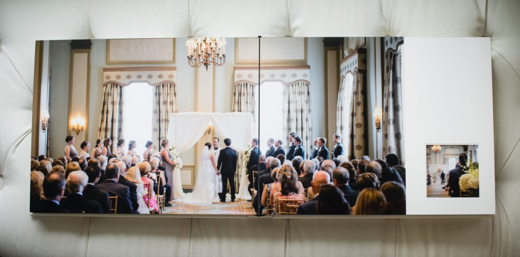 Over-all photo of a ceremony in a wedding album.