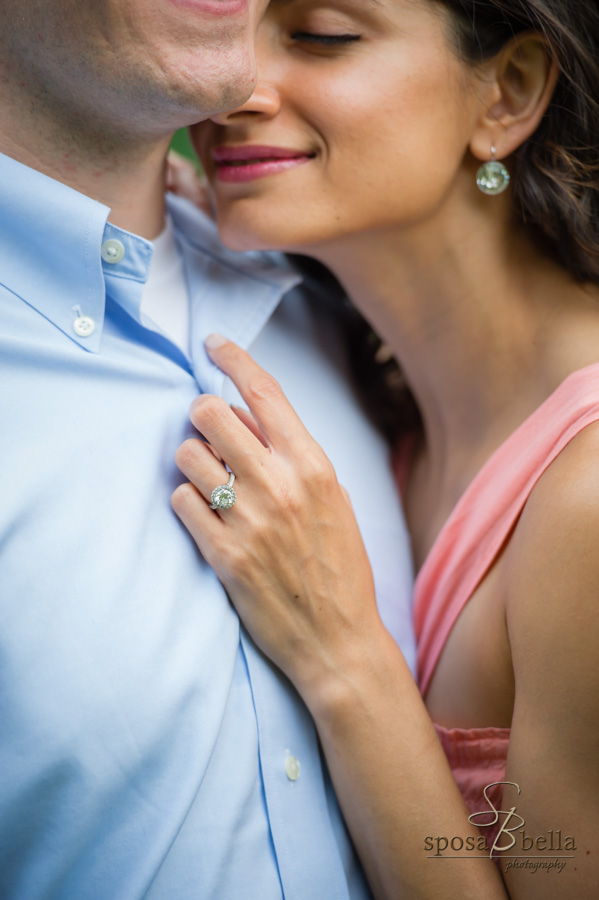 Seema snuggles up to her fiancé and the photographer captures her beautiful engagement ring.