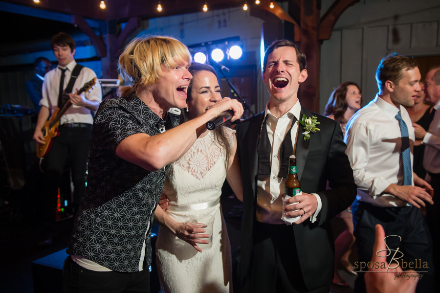 Bride and groom join the band in singing during their reception at the High Hampton Inn.