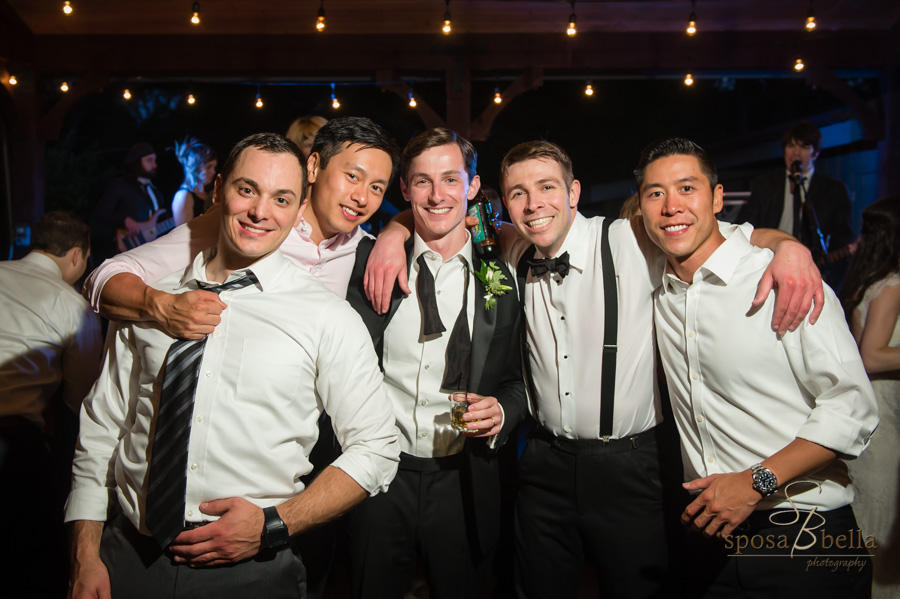 The groom and his friends pause during the reception for a quick photo.