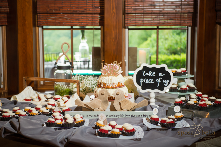 A dessert table, complete with a gold, sparkly Dr. and Mrs. sign on the cake.