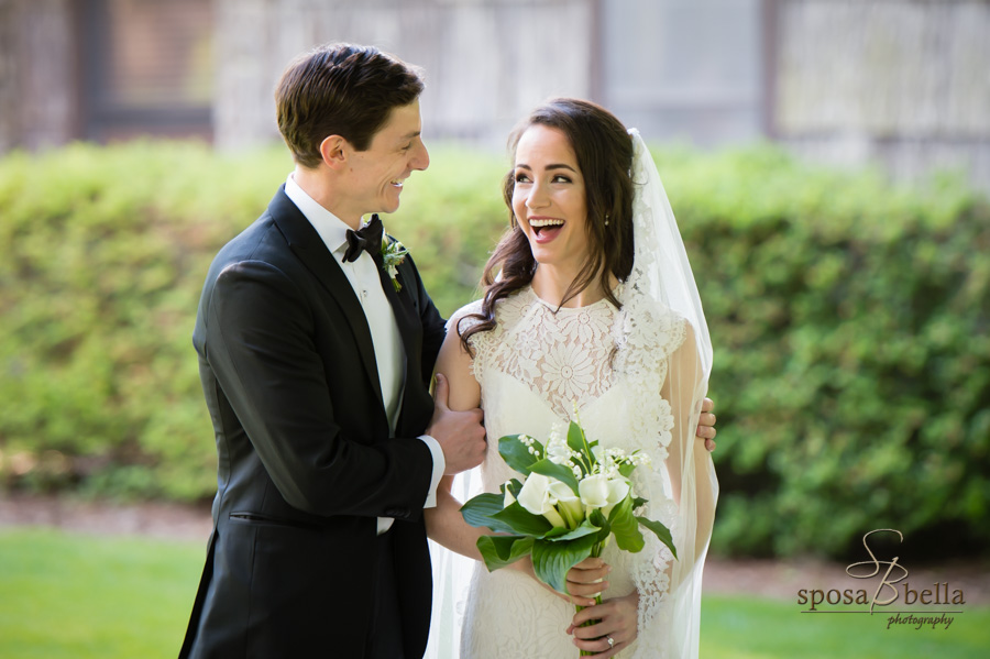 Bride reacts with happiness to seeing her groom during their first look.