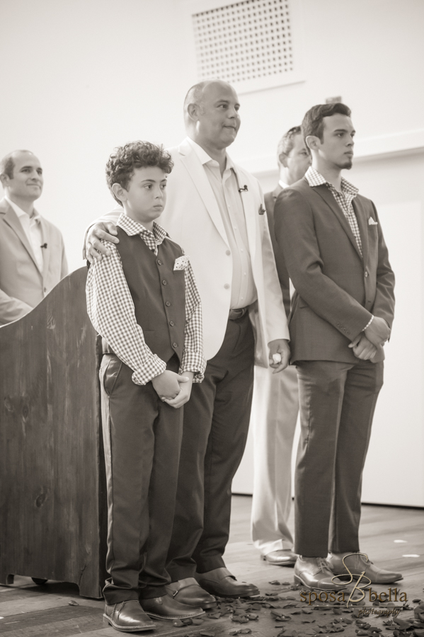 The groom and his two sons anxiously await the bride.