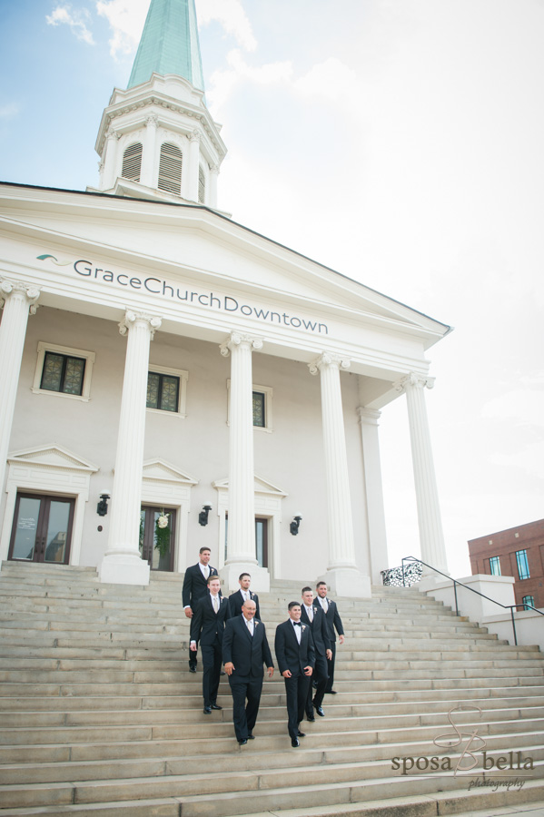Groomsmen walking down steps in front of Grace Church, Downtown Greenville.