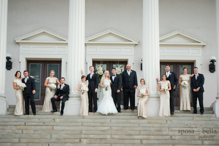 Wedding party posing for a photo in between the massive columns of Grace Church Downtown.