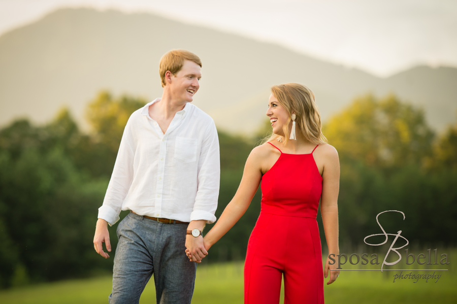The adorable couple smiles at one another after becoming engaged.