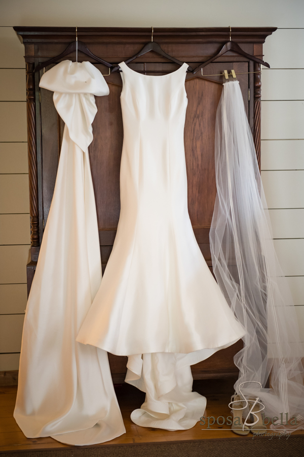Leland's dress and veil hang from the beautiful wooden dresser at Old Edward's Inn in Highlands.