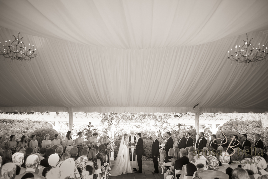 The couple's ceremony felt intimate yet open in an outdoor structure complete with chandeliers.