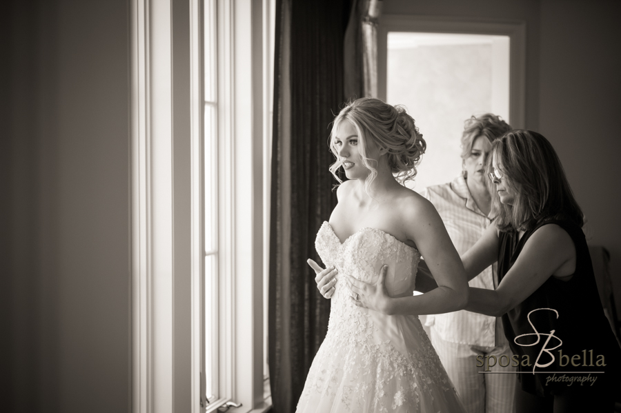 Bride getting dressed.