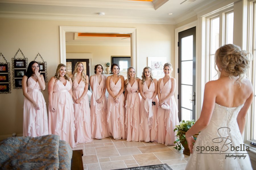 Bride's first look with bridesmaids.