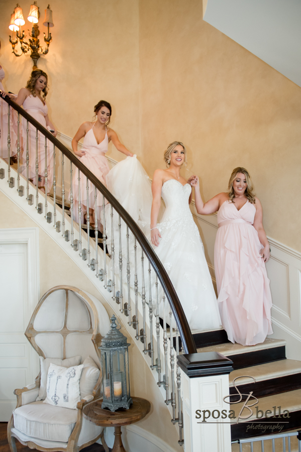 Bride descends staircase.
