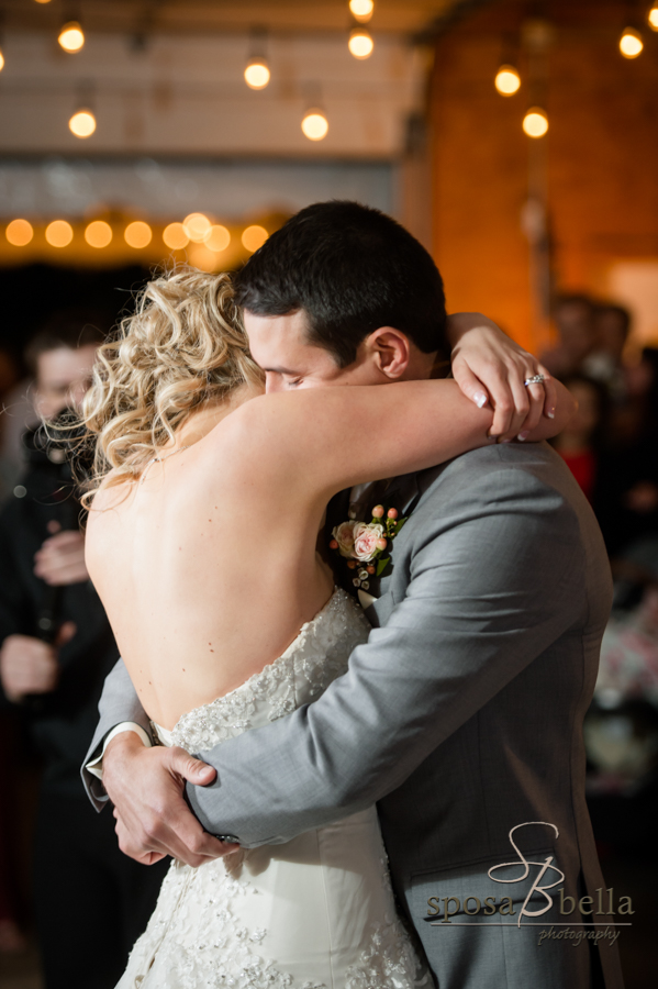 Happy newlyweds dance at their wedding reception.